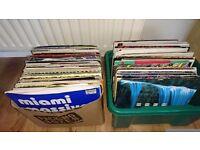 2 boxes of vinyl records