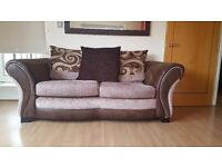 Three-seater fabric sofa from DFS with cushions