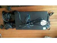 Playstation 2 with 2 controllers and leads
