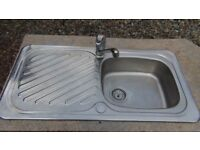 kitchen sink with mixer tap and fixings