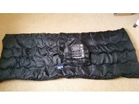 Brand new black single sleeping bag with tags