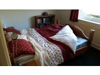 Wooden double bed and 2 bedside cabinets