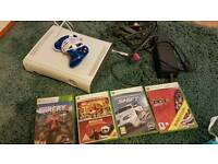 Xbox 360 console with a few games and controller,cables, hdmi cable too. Please read below too