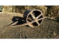 Vintage cast iron field roller garden ornament