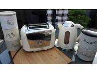 Kettle, toaster, tea, coffee, sugar and buscuit stacking canisters