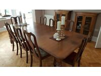Large Antique Oak dining table with 8 chairs. Fully modular and can be adjusted to size.