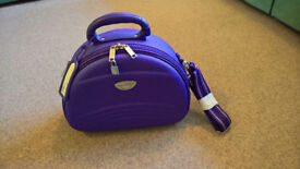 Purple vanity case made by Borderline (since 1907) for cosmetics, makeup or hair items