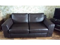 Large two seater brown leather sofas