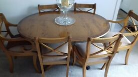 Reproduction Yew extending dining table and 6 chairs