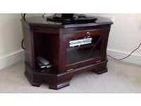 Classic TV Cabinet in mahogany with glass front display door.