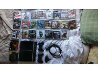 PS3 with 2 controllers wireless keypad and 25 games