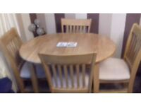 Immaculate extending dining room table and chairs