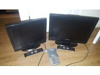 Two TV with remotes and a wall bracket