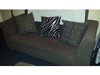 3 seater brown fabric sofa.