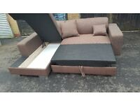 Lovely BRAND NEW brown fabric corner sofa. makes good size bed.got storage. can deliver
