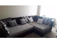 Large settee corner unit with footrest.