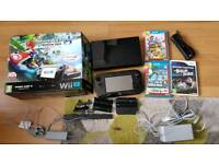 Nintendo Wii U complete in box and 3 games