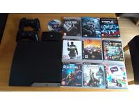 PS3 Slim Line 160 GB + 8 Games, 2 Blue Rays , 2 Controllers & Play TV Hardware w/ Disc