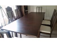 Ikea extendable Bjursta dining table and 6 chairs