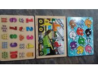 Collection of wooden jigsaw puzzles for infants