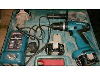 Makita 14v 3.0 with 3 bateries in working order ! can deliver or post!
