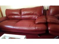 2 3 seater settees red leather ,small marks on back but not noticeable great sturdy settee
