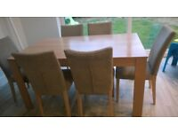Dining Table and 6 chairs at bargain price