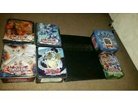 1500+ Yugioh cards + 6 Tins + Folder