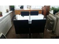 2 Tiered Glass Dining Table & 4 leather chairs