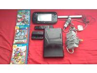 Nintendo Wii U console with three games.