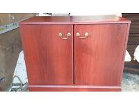 mahogany wood 2 door unit with shelve inside