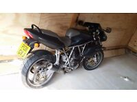 Ducati 900ccs. Mint condition. Carbon Fiibre Mud Guards.