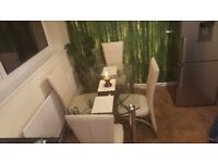 Extendable glass dinning table with 4 chairs