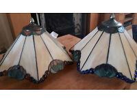Two Tiffiany style lampshades.