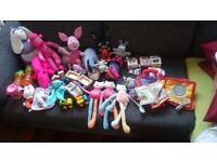 Box of baby toys, stuffed animals and unused dummies