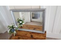 Silver framed Bevelled mirror in very good condition