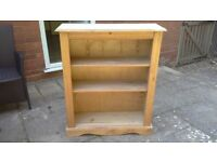 Pine bookcase, with two adjustable shelves.