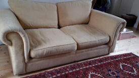 2 seater sofabed in golden yellow fabric
