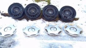 4 X 15 inch STEEL RIMS AND TRIMS FROM MERCEDES - FREE FOR UPLIFT