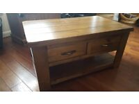 Coffee table with 2 draws. Beautiful wooden piece of furniture in excellent cond. Cost 250 new.