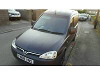Vauxhall combo crew van it as seats in back that folds down flat factors fitted