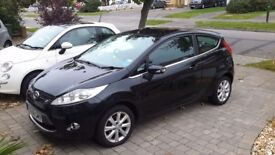 Ford fiesta black, two door, good condition