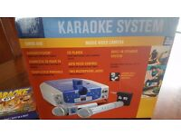 Karaoke Machine and 2 mics plus 10 music discs