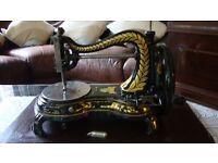Antique Jones Serpentine Sewing Machine.