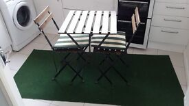 Small folding table with two folding chairs