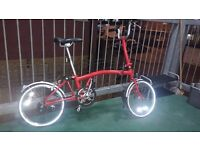 Red 3 speed Brompton folding bicycle