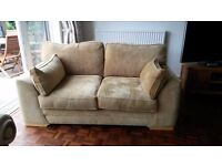 Modern Two Seater Settee, excellent condition, Golden Sand Coloured Fabric, Light Oak Feet