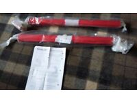 Pair brand new red black-out roller blinds