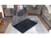 Large cage for a dog or cat. Nearly New in box with instructions.