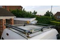 Transit connect LWB Rhino bar roof rack with rear roller and board stop
